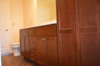 A photo of brown bathroom cabinets in a manufactured home.